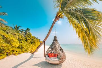 Chill lounge zone on the sandy beach, Maldives island. Beautiful tropical Maldives beach under...