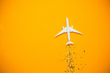 Toy airplane with sparkles on yellow background. Journey Fototapete
