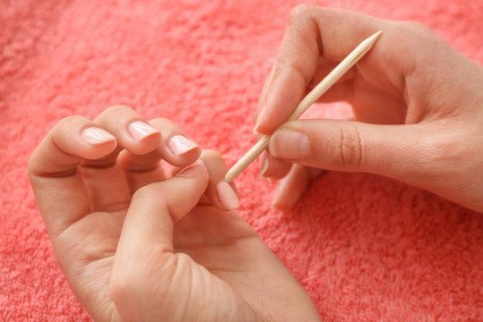 Woman doing manicure, closeup