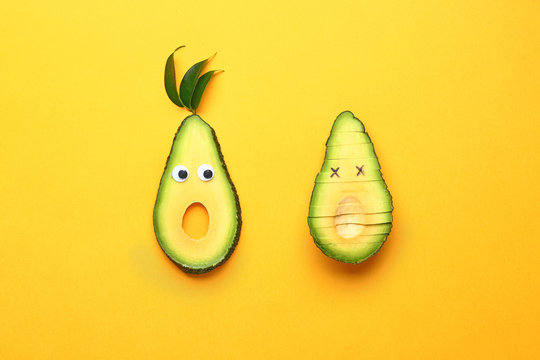 Creative composition with avocado on color background