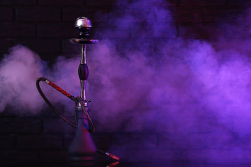 Hookah with fume on dark background