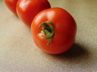 Red tomatoes on nice background. Fresh and healthy food for meal.