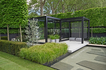 Photo sur Toile Jardin A cool modern garden with some Scandinavian style and a water feature
