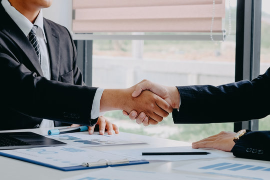 Handshaking. Two businessman shaking hands during a success meeting.