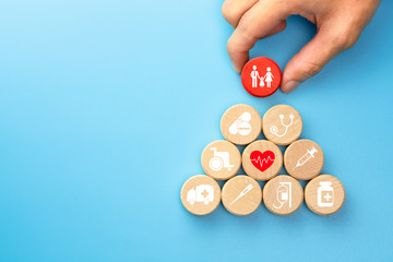 Health insurance concept, Hand holding a wood cubes with healthcare medical icon, blue background, copy space Wall mural