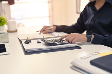 Finance concept, Businessman calculate on table.