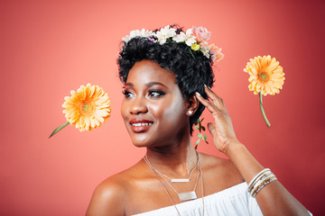 Portrait of a Beautiful Black Woman smiling with Flowers in her Hair