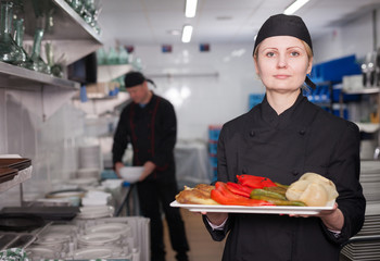 Woman cook with finished dish
