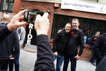 Members of The San Francisco Gay Men's Chorus pose for photos after they sang on the street in front of the historic gay bar the Stonewall Inn in the Manhattan borough of New York