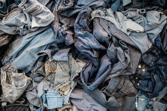 Pile of Old Vintage Denim Jeans Being Repurposed