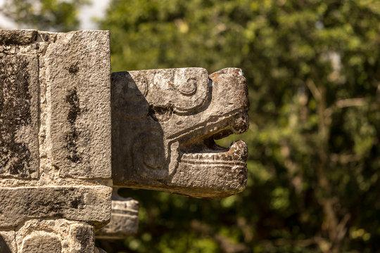 Jaguar head carved in stone at Chichen Itza Mayan civilizations ruins in Mexico