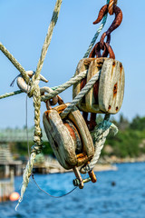Marine block and tackle at a wharf in a rural fishing community in Nova Scotia