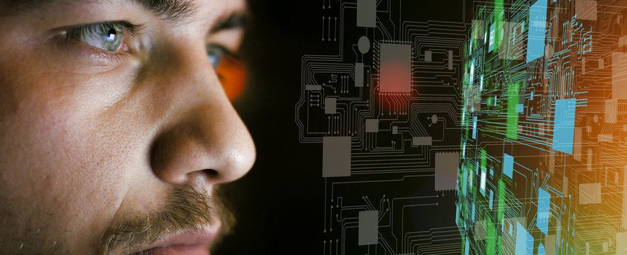 Young man in front of circuit board architecture - technology concept