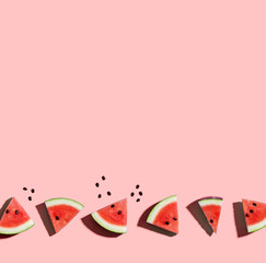 Wall Mural - Sliced watermelons arranged on a pink background