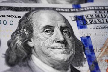 Close up portrait of Benjamin Franklin on hundred dollar baknote.
