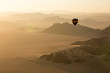 Hot air balloon ride over the sand dunes in the Namib Desert at sunrise; Sossusvlei, Hardap Region, Namibia