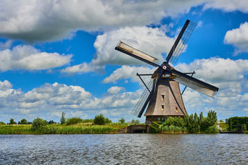 Netherlands rural lanscape with windmills at famous tourist site Kinderdijk in Holland. Old Dutch village Kinderdijk, UNESCO world heritage site.