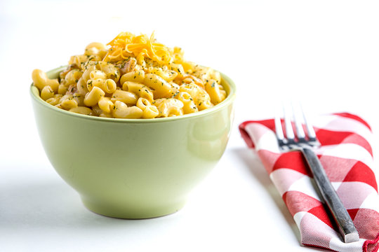 Mac and cheese in a green bowl.