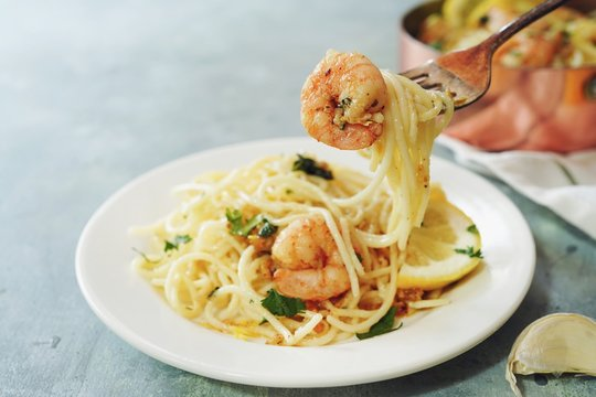 Homecooked Shrimp Scampi with Spaghetti pasta and lemon
