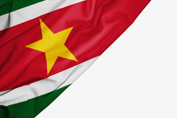 Suriname flag of fabric with copyspace for your text on white background.