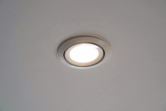 LED downlight or ceiling light Installed on a gray ceiling close up.