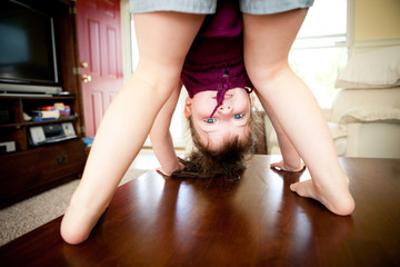 Silly Little Girl Looking Through Legs Upside Down