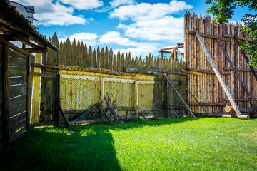 Medieval wooden fence made of palisade