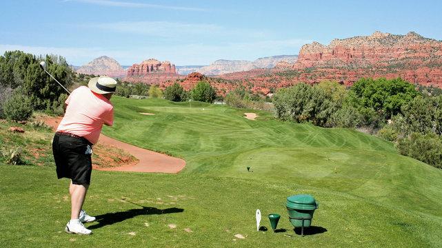 Golfer driving the ball on a Sedona Arizona golf course