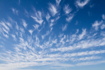 sky background with white cirrus clouds; vibrant sky background with diminishing perspective
