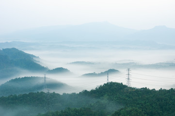 Electric transmission towers in fog