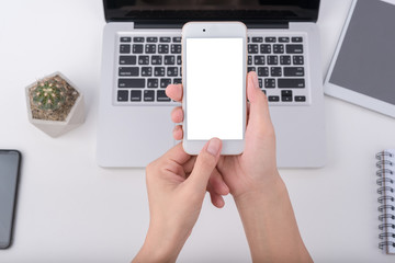 hand hold smartphone and touching on workspace table