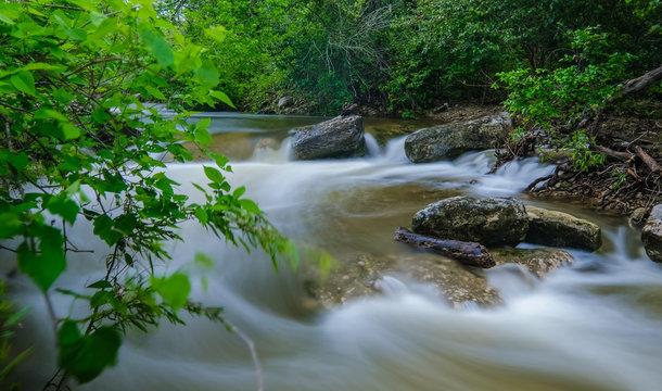 Small waterfall on Bull Creek Austin Texas spring