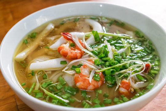 Classical Vietnamese soup pho with rice noodles and seafood with green onion tasty
