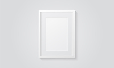 Picture frame isolated on a wall. White color. Realistic modern template. A4 vertical format. Mock up for pictures or photo. Beautiful minimal clean design. Eps 10 vector illustration.