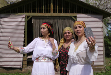 A family of Romanian witches livestream a ritual on Facebook for their followers, in Mogosoaia