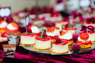 candy bar at the wedding. sweet cupcakes decorated with raspberr Wall mural