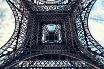 Fototapete - Eiffel tower in Paris viewed from below