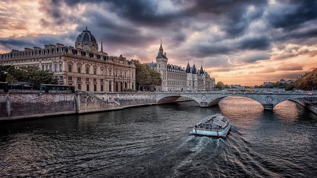 Conciergerie and Seine river in Paris at sunset