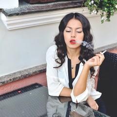 Beautiful smoking young woman outdoor portrait