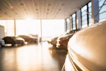 New cars at sunlit dealer showroom close view Wall mural