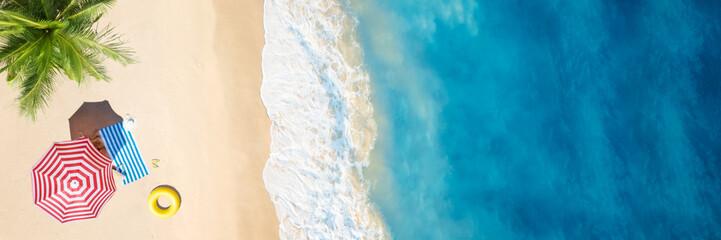 Wall Murals Beach Aerial view of umbrella,towel on sand beach
