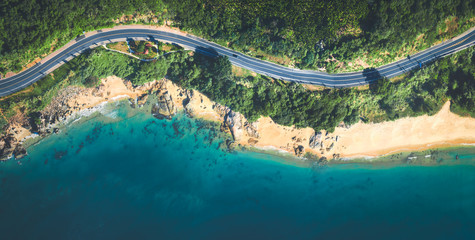 Aerial view of the sandy beach and  road