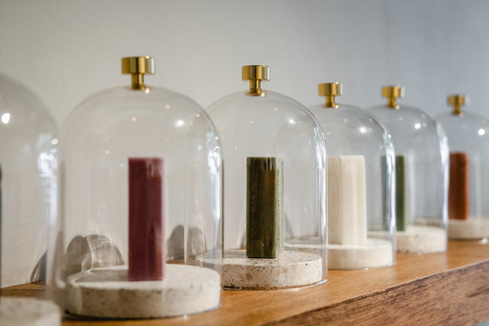 Natural soap bars with herbs under the glass domes, cloche. Spa salon, healthcare store, minimalism concept