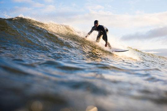 Young Man exploring Nova Scotia for a travel surf trip