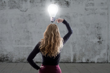 woman thinking with the light bulb on