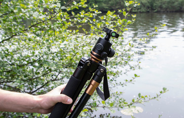 tripod for a camera with a 3D head in nature
