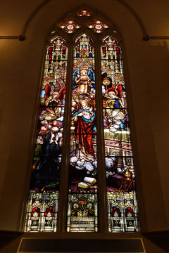 Stained glass window in Saint Michael's Cathedral Toronto of Jesus revealing His Sacred Heart to Sister Margaret Mary