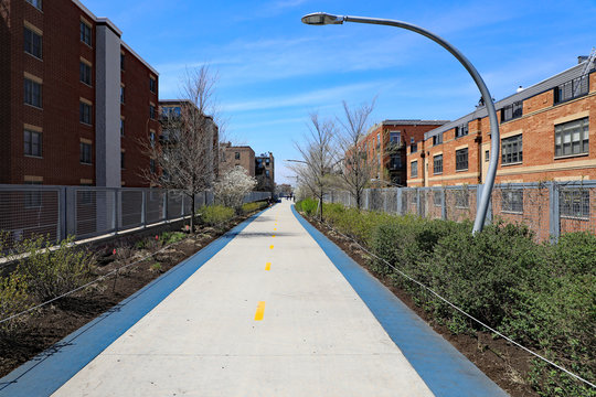 A new elevated park in Chicago called the 606 or the Bloomingdale Trail is enjoyed by people walking, skating, jogging, or riding a bicycle.  It is on a former freight train track that was elevated.