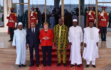 German Chancellor Merkel poses for a group photo at G5 Sahel in Ouagadougou