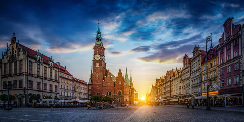 Wroclaw central market square with old houses and sunset. Panoramic evening view, long exposure, timelapse.  Historical capital of Silesia, Wroclaw (Breslau) , Poland, Europe.